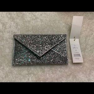 Tory Burch ($148) silver glitter wallet